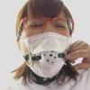 マスクの上からボールギャグの口枷をされ監禁拘束されるメガネっ娘巨乳な歯科助手・大島あいる
