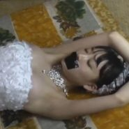 縛られ口をガムテープで塞がれたウェディングドレス姿の女子校生花嫁
